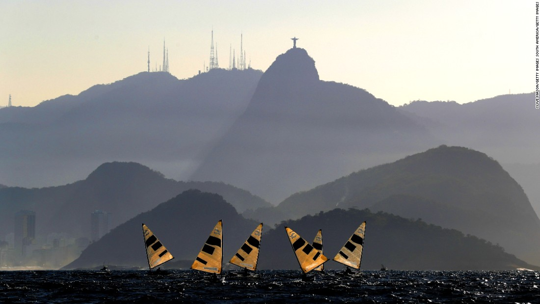 "This image, taken ""late in the afternoon"" on the Copacabana, depicts the ""abstract"" sails of the Finn fleet positioned directly below Christ the Redeemer. It's a photo that could adorn the wall of any home; indeed, Mason confirms he's had numerous requests for prints."