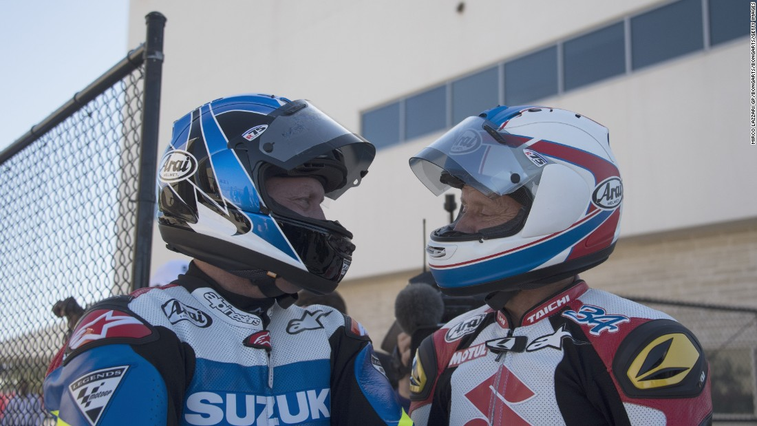 "Americans Kenny Roberts Jr.  and Kevin Schwanz speak during ""Suzuki honour lap"" before the MotoGP race  in Austin, Texas. Roberts Jr. was recently inducted into the MotoGP Hall of Fame."