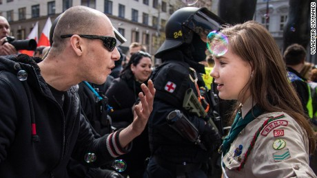 Girl Scout Lucie Myslíková, 16, squares off with a right-wing demonstrator.