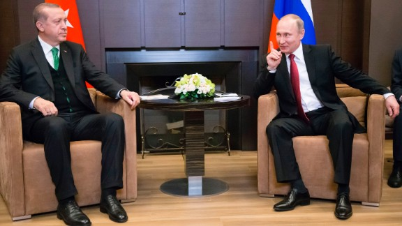 Recep Tayyip Erdogan (L) meets with Vladimir Putin in Sochi on Wednesday.