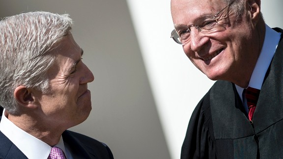 Neil Gorsuch (L) smiles at Supreme Court Justice Anthony Kennedy before taking the judicial oath during a ceremony in the Rose Garden of the White House April 10, 2017 in Washington, DC.