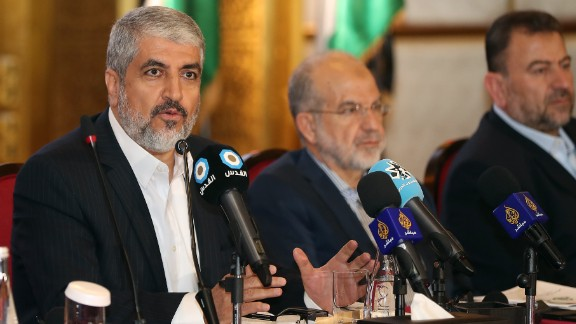 Exiled Chief of Hamas' Political Bureau Khaled Meshaal (L) speaks during conference in the Qatari capital, Doha on May 1, 2017. The Palestinian Islamist movement Hamas unveiled a new policy document easing its stance on Israel after having long called for its destruction, as it seeks to improve its international standing. / AFP PHOTO / KARIM JAAFAR        (Photo credit should read KARIM JAAFAR/AFP/Getty Images)