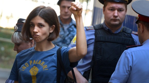 """Member of female punk band """"Pussy Riot"""" Nadezhda Tolokonnikova gestures before a court hearing in Moscow on August 8, 2012."""