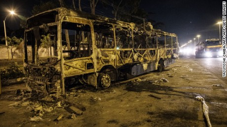 The wreckage of a bus burnt down by traffickers remains on Avenida Brasil in Rio de Janeiro, Brazil, on May 2, 2017.  Two suspected drug gang members were killed Tuesday in Rio de Janeiro when police intervened to stop clashes between rival factions and a wave of bus burnings and lootings. Police blamed rival drug gangs for the surge of violence in and around a slum lying along Avenida Brasil, one of the city's main arteries. / AFP PHOTO / YASUYOSHI CHIBA        (Photo credit should read YASUYOSHI CHIBA/AFP/Getty Images)
