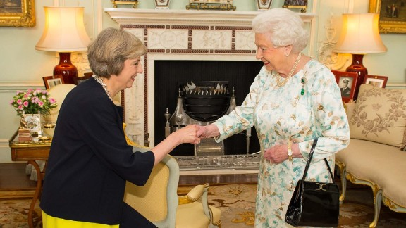 British Prime Minister  Theresa May curtsies to the Queen.