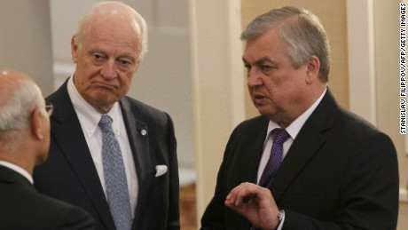 UN envoy Staffan de Mistura, left, and Russian mediator Alexander Lavrentyev confer Thursday.