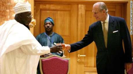ABUJA, NIGERIA:  Nigerian President Olusegun Obasanjo (L) toasts with Prince Philip, Duke of Edinburgh, during a reception in honor of Britain's Queen Elizabeth II at the State House in Abuja, Nigeria, 03 December 2003. Queen Elizabeth II arrived in Nigeria 03 December two days ahead of the Commonwealth summit, on her first state visit since the country won its independence from her rule in 1956.   AFP PHOTO/NIC BOTHMA/POOL   (Photo credit should read NIC BOTHMA/AFP/Getty Images)