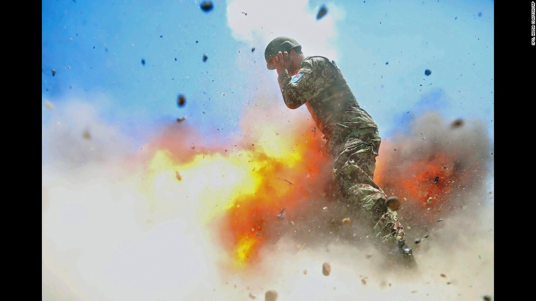 "In this photo -- <a href=""http://www.cnn.com/2017/05/03/us/moment-of-explosion-trnd/"" target=""_blank"">published this week</a> by Military Review, the US Army's professional journal -- a mortar tube explodes near an Afghan soldier during a training exercise in July 2013. The photo was taken by US Army Spc. Hilda Clayton, a combat photographer who was killed in the accident along with three Afghan soldiers and the Afghan photographer she was training. Clayton's family approved the release of the photo, <a href=""https://www.stripes.com/news/army-releases-images-of-combat-photographer-s-final-moments-before-fatal-blast-1.466230#.WQua-LvyvJy"" target=""_blank"">according to the Stars and Stripes newspaper,</a> and the Military Review featured it as part of its issue on gender equality."