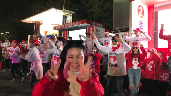 Supporters of South Korean presidential candidate Hong Jun-pyo perform outside a TV station prior to a televised debate.