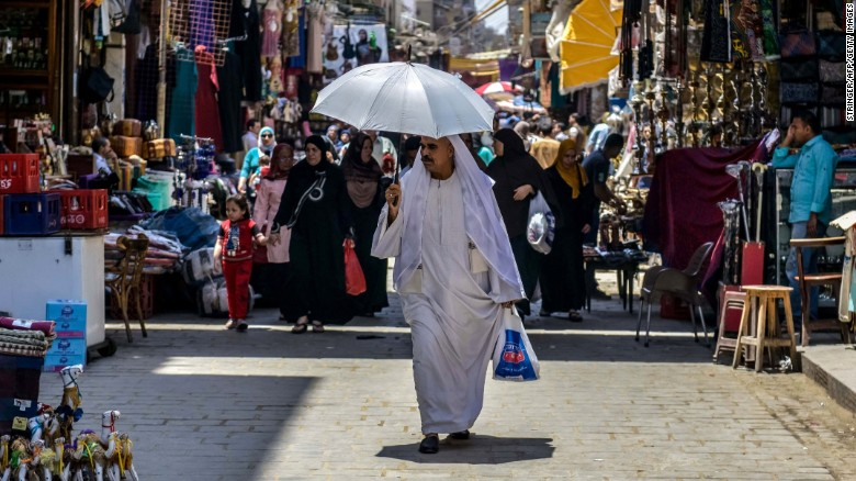 An Egyptian man walks down the street at the Khan al-Khalili market in Cairo on May 20, 2016. The latest EgyptAir plane crash is another crushing blow to a country whose tourism-dependent economy is struggling to recover from years of jihadist attacks and political turmoil, analysts said.