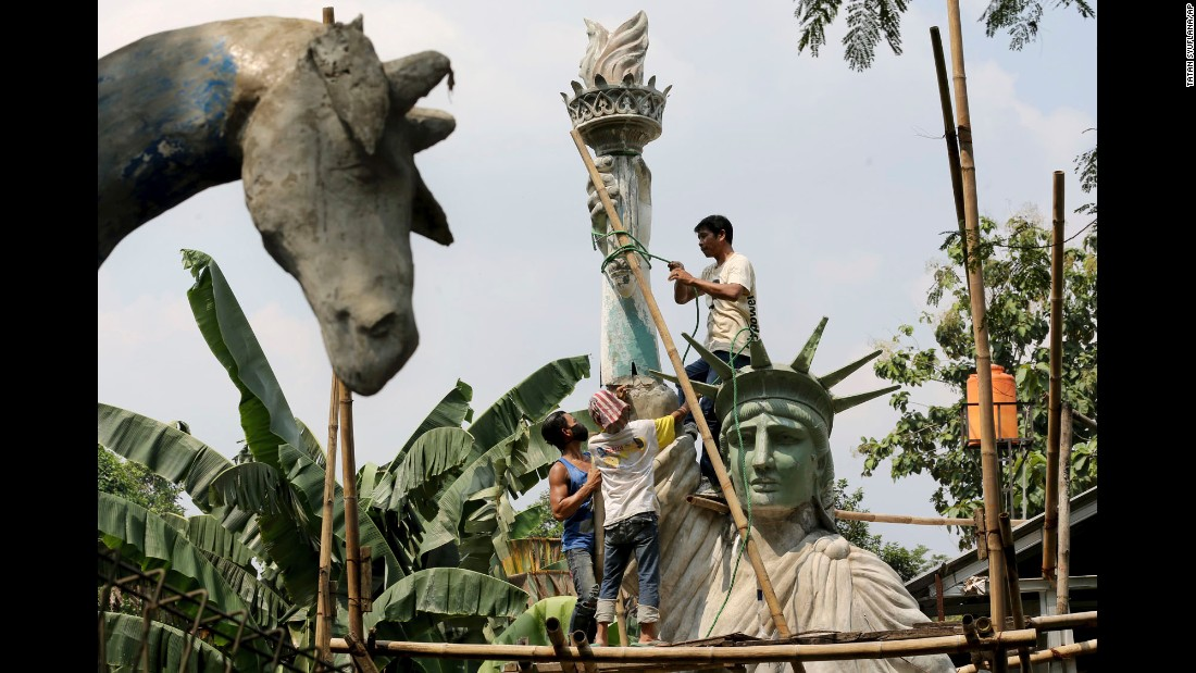 Workers build a large replica of the Statue of Liberty at a workshop in Jakarta, Indonesia, on Thursday, May 4. The sculpture will be installed at a public park to attract more visitors.