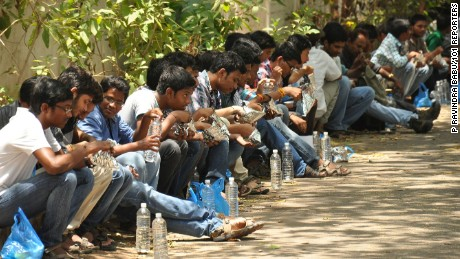 Students having their lunch after appearing in the JEE (Advanced) exam paper-1 at Siddhartha Mahila Kalasala in Vijayawada on Sunday. 101Reporters