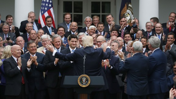 President Donald Trump (C) congratulates House Republicans after they passed legislation aimed at repealing and replacing ObamaCare, during an event in the Rose Garden at the White House, on May 4, 2017 in Washington, DC.