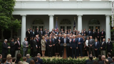 President Donald Trump speaks while flanked by House Republicans after they passed legislation last week aimed at repealing and replacing Obamacare.