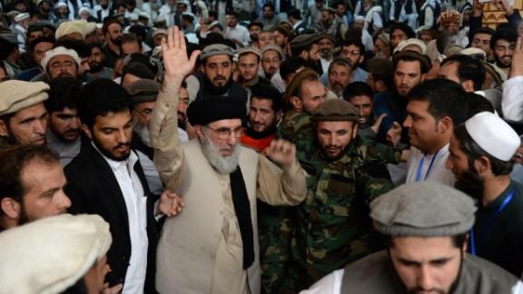 Hekmatyar gestures as he arrives at a rally in Jalalabad last week.