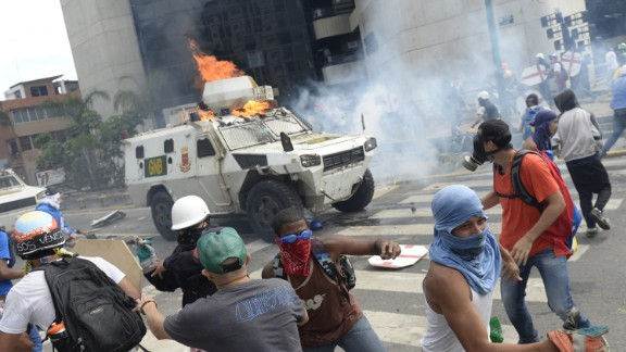A charging National Guard riot control vehicle is hit by a Molotov cocktail thrown by a demonstrator during a protest against Venezuelan President Nicolas Maduro, in Caracas on May 3, 2017. Venezuela