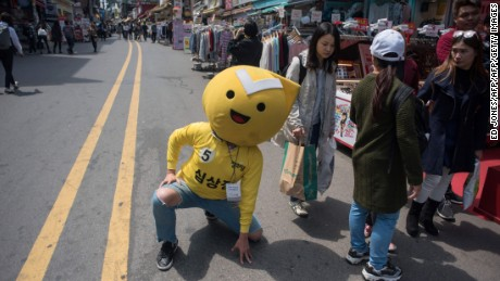 A supporter of South Korean presidential candidate Sim Sang-Jung poses on a street prior to a campaign rally event in Hongdae, Seoul.