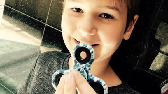 Alex Shivers shows off his camo-printed spinner.