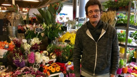 Macron has won flower merchant Jean-Michel Dewelle's vote in both the first and second rounds.