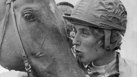 Diane Crump, apprentice jockey, kisses her mount,  Tou Ritzi, after winning the second race at Churchill Downs in Louisville, Kent., April 29, 1969. This was her fifth win as a jockey and first at Churchill Downs. (AP Photo/Gene Herrick)