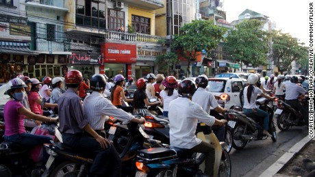 Bikes and bustling in Hanoi during rush hour.