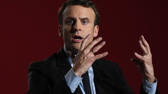 French presidential election candidate for the En Marche ! movement Emmanuel Macron gestures as he gives a speech during a meeting in Arras, on April 26, 2017, ahead of the second and final round of the presidential election. / AFP PHOTO / Eric FEFERBERG        (Photo credit should read ERIC FEFERBERG/AFP/Getty Images)