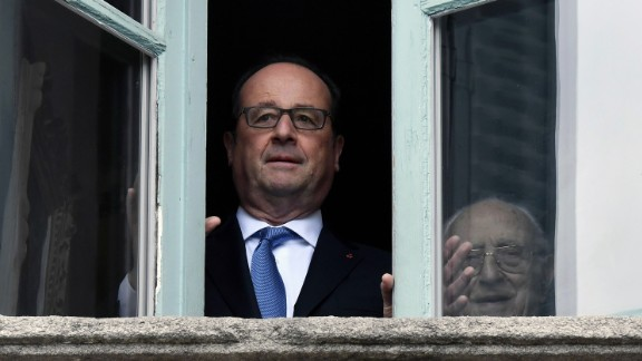 Outgoing French President Francois Hollande looks out of a window in Tulle, France on May 7.