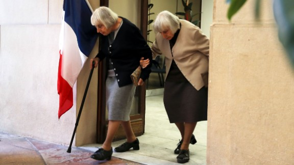 Twin sisters leave a polling station in Nice, France after voting on May 7 in the second round of the French presidential election.