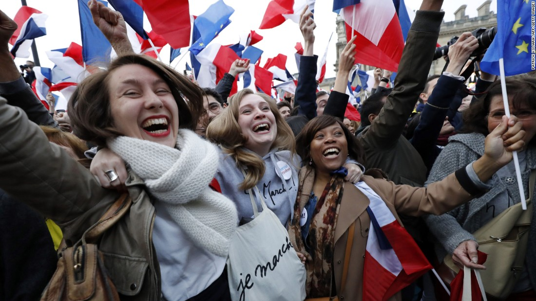 Supporters of Macron celebrate at the Louvre Museum in Paris on May 7.