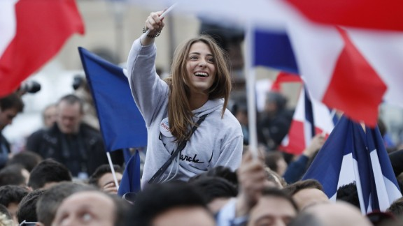 A supporter of French presidential election candidate for the En Marche ! movement Emmanuel Macron celebrates in front of the Pyramid at the Louvre Museum in Paris on May 7, 2017, following the announcement of the results of the second round of the French presidential election. Emmanuel Macron was elected French president on May 7, 2017 in a resounding victory over far-right Front National (FN - National Front) rival after a deeply divisive campaign, initial estimates showed. / AFP PHOTO / Patrick KOVARIK        (Photo credit should read PATRICK KOVARIK/AFP/Getty Images)