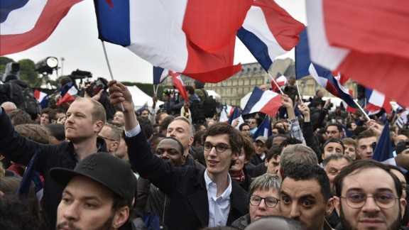 Supporters of French presidential candidate Emmanuel Macron celebrate outside the Louvre in Paris after Macron won the second round of the election.