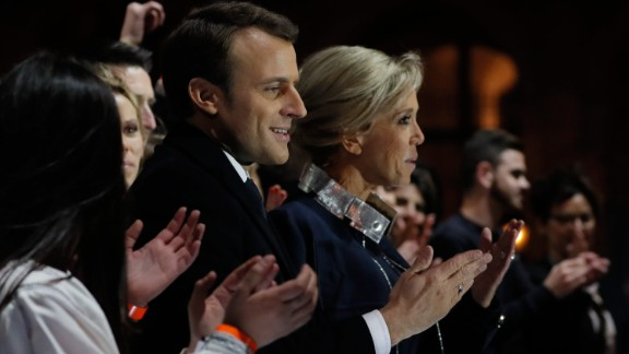 French President-elect Emmanuel Macron stands with his wife Brigitte Trogneux in front of the Pyramid at the Louvre Museum in Paris on Sunday, May 7, 2017, after the second round of the French presidential election. Macron soundly defeated far-right candidate Marine Le Pen.