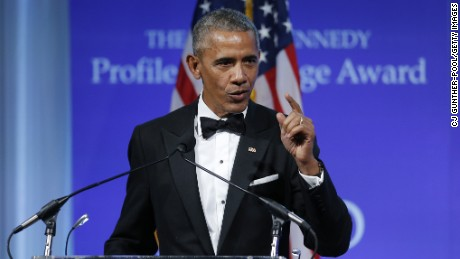 Obama touts his climate change work as Trump mulls ditching Paris accord