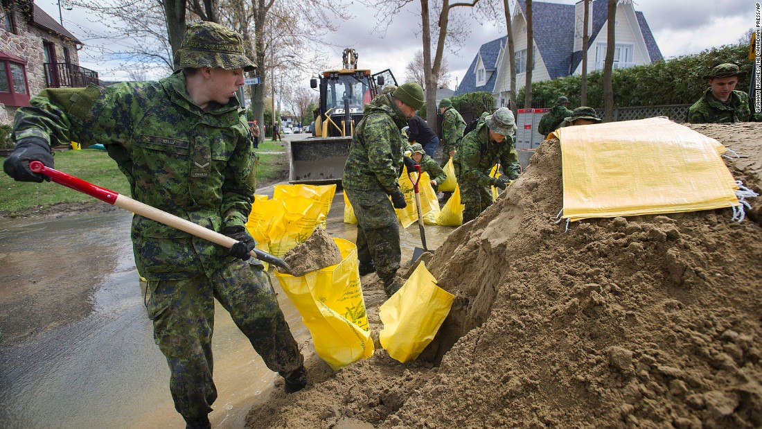 Members of the Canadian armed forces fill sandbags in Montreal on May 7.