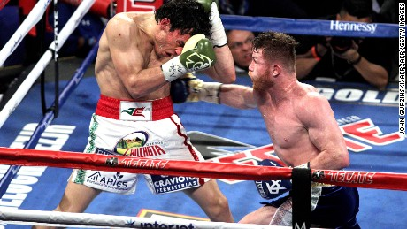 "Canelo Alvarez (R) slams a right against Julio Cesar Chavez, Jr. on May 6, 2017 at the T-Mobile Arena in Las Vegas, Nevada. Saul ""Canelo"" Alvarez cruised to a unanimous decision win over Julio Chavez Jr. in a 12-round beatdown to claim Mexican bragging rights on Cinco de Mayo weekend.  / AFP PHOTO / JOHN GURZINSKI        (Photo credit should read JOHN GURZINSKI/AFP/Getty Images)"