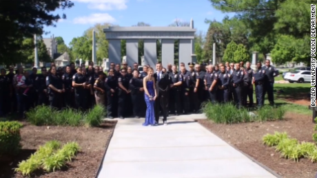 Sierra Bradway and date Brock Spayd with police officers at her father's gravesite.