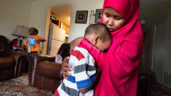 Suaado Salah comforts her son Luqman, 3, at their apartment in Hopkins, Minnesota on April 27. Luqman and his 18-month-old sister got the measles during the current outbreak in Minneapolis and are now fully healing at home. Brother Abdullahi, 5, left, did not get sick and has now been vaccinated. Salah had previously refused the MMR shot for them because of rumors that it caused autism. She has since changed her mind and is upset that the connection is still being touted by anti-vaxxers.