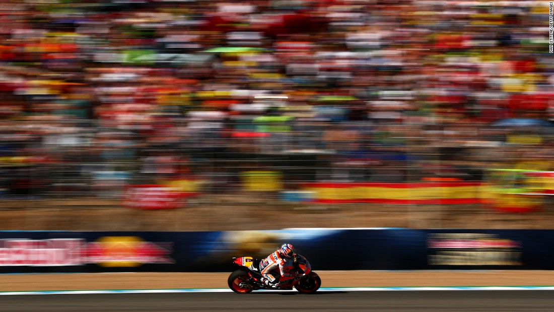 Dani Pedrosa rides his motorcycle Sunday, May 7, before the start of the MotoGP race in Jerez de la Frontera, Spain. Pedrosa won the race.