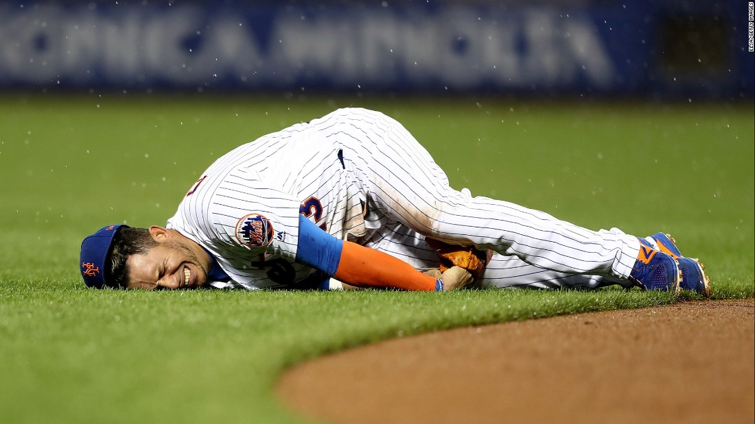 Asdrubal Cabrera grimaces after injuring his thumb during a Major League Baseball game in New York on Saturday, May 6. Cabrera, a shortstop for the New York Mets, hurt himself while diving for a ground ball.