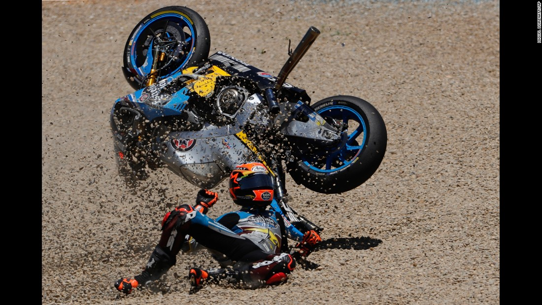 MotoGP rider Tito Rabat falls from his bike during the Spanish Grand Prix on Sunday, May 7.