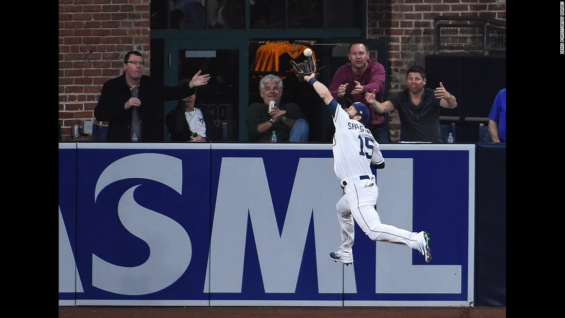 San Diego outfielder Cory Spangenberg leaps for a catch during a home game against Colorado on Tuesday, May 2.