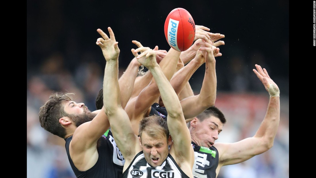 Players compete for the ball during an Australian Football League match in Melbourne on Saturday, May 6. Facing the camera, from left, are Ben Reid, Matthew Kreuzer and Levi Casboult.