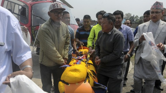 Officials carry Min Bahadur Sherchan's body to a hospital in Kathmandu on May 7.