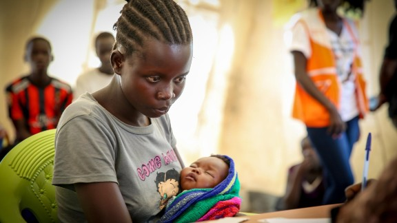 Blessing sits in a processing center, cradling her days-old infant hoping that one day she will be reunited with her parents. As a young mother with a baby daughter Blessing will receive special protection and services.