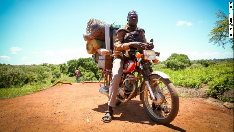 Victor Patrick has been helping the displaced carry the few belongings they were able to escape with to their new home in Uganda.