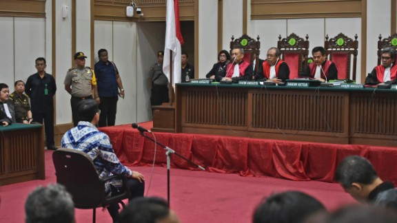 Ahok sits on the defendant