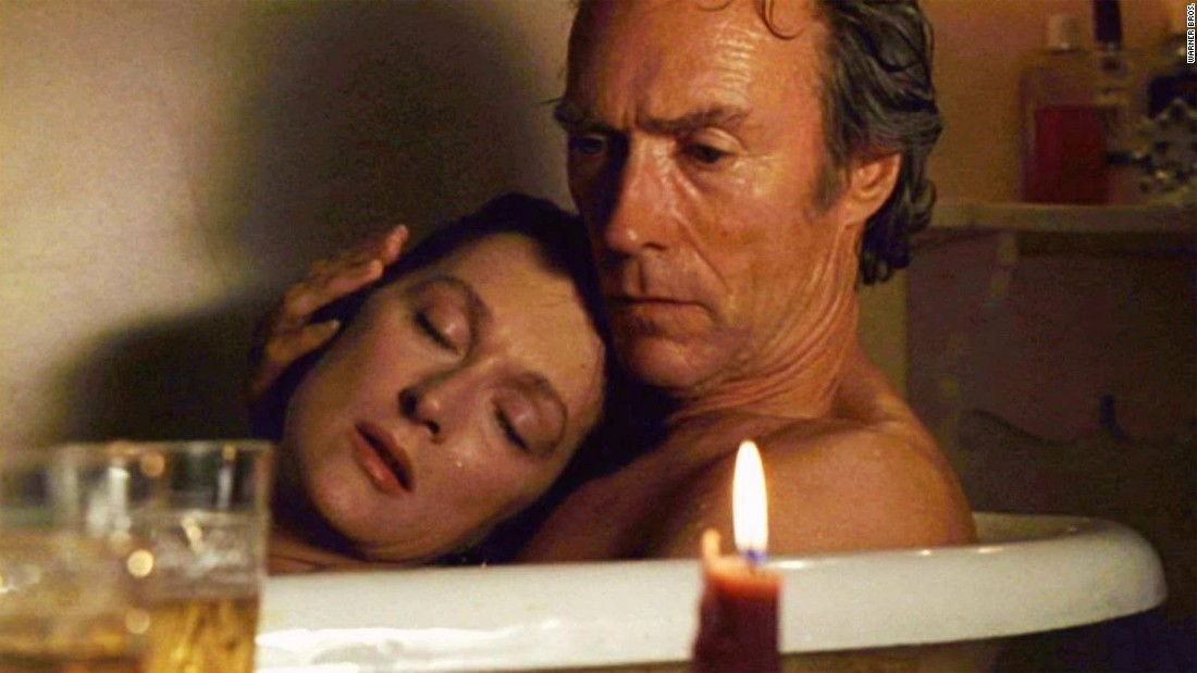 "Two soul mates meet after it's too late to spend their lives together. That's the tragic story behind this tender moment between National Geographic photographer Robert (Clint Eastwood) and housewife Francesca (Meryl Streep) in the 1995 film ""The Bridges of Madison County."""