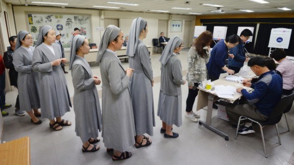 South Korean Catholic nuns line up to cast their ballots Tuesday in Seoul.