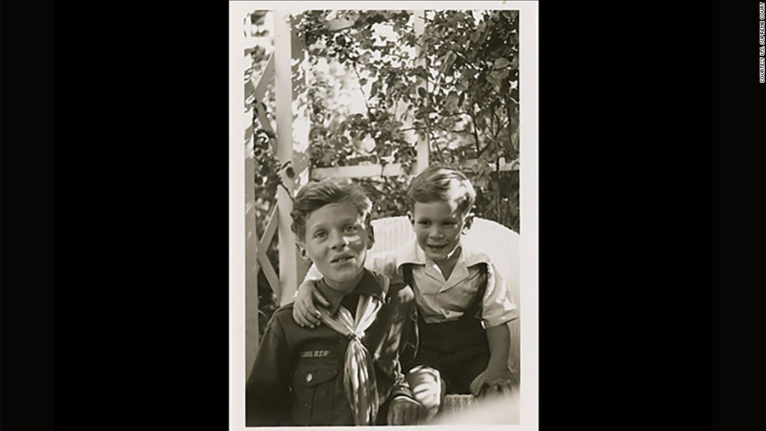 Kennedy wears his Cub Scout uniform as he poses with his brother, Tim, circa 1946.