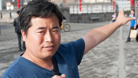 Michael Chang has been guiding tourists in Xi'an for eight years.